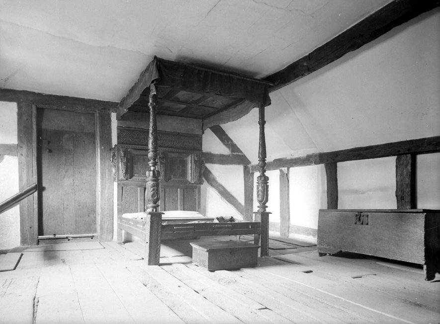 Anne Hathaway's cottage in Shottery, showing bedroom with carved bedstead.  September 1946 |  IMAGE LOCATION: (Warwickshire County Record Office)
