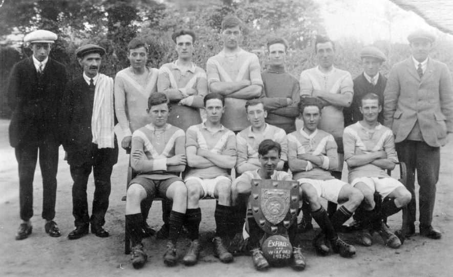 Team photograph of Exhall & Wixford football team with the shield which they won in 1923/24. |  IMAGE LOCATION: (Warwickshire County Record Office)