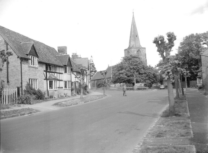 Street with cottages, looking towards parish church in Tanworth in Arden.  1957    IMAGE LOCATION: (Warwickshire County Record Office)