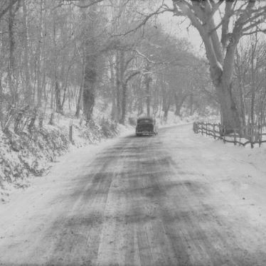 Exhall, nr Alcester.  Country road under snow