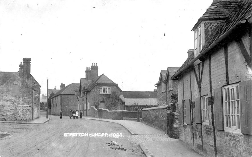 Village street with timber framed house. Children and public house in the background, Stretton under Fosse.  1900s |  IMAGE LOCATION: (Warwickshire County Record Office)