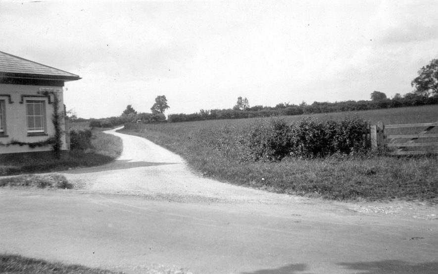 View of The Ridgway and part of the tollhouse, Shottery. Bishopton lane enters The Ridgway at the curve in the distance.  1927 |  IMAGE LOCATION: (Warwickshire County Record Office)