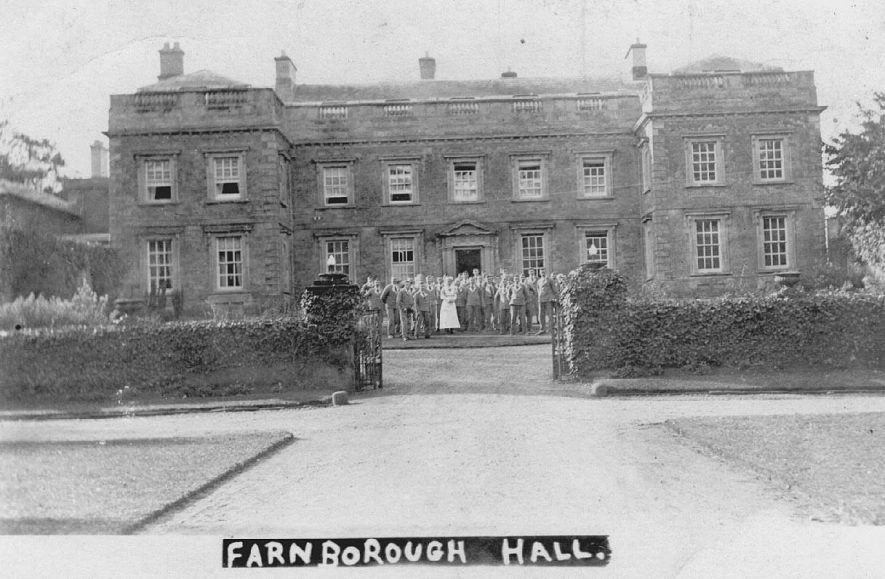 Farnborough Hall when used as a hospital in Great War.  Group of patients (soldiers) with nurse.  1914-18 |  IMAGE LOCATION: (Warwickshire County Record Office)