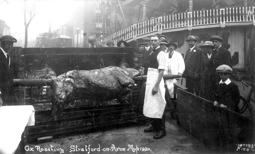 Ox roasting at the Mop Fair, Stratford upon Avon.  1920 |  IMAGE LOCATION: (Warwickshire County Record Office)