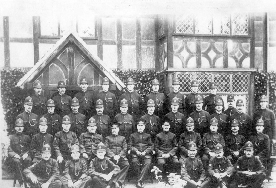 Stratford upon Avon Division of Police.  From left to right.  Back row.  P.C. Bazeley, P.C. Usher,  --- , P.C. Wilkes, P.C. Wright, P.C. Rawlings, P.C. Barnes, P.C. Setterfield, P.C. Sumner. 2nd row, P.C. Wall, P.C. Garbett, P.C. Bennett,  P.C. Williams, P.C.Sampson, P.C.Garner, P.C.Hunt, P.C.Hirons, P.C.Masters, P.C.White, P.C.Miles, P.C.Lines. 3rd row, P.C.Pink, Sgt.Cone, Sgt.Brown  Sgt.Titmuss, Inspr. Mellor, Supt.Lee, Inspr Boneham, Sgt Cleaver, Sgt Saunders P.C.Heavens, P.C.Mundy.  Front row,  P.C.Taylor, P.C.Davol, P.C.Mackimmie,  P.C.Frost, P.C.Baxter, P.C.Bowers. |  IMAGE LOCATION: (Warwickshire County Record Office) PEOPLE IN PHOTO: Wright, Police Constable, Wright as a surname, Williams Police Constable, Williams as a surname, Wilkes, Police Constable, Wilkes as surname, White, Police Constable, White as a surname, Wall, Police Constable, Wall as a surname, Usher, Police Constable, Usher as a surname, Titmuss, Police Sergeant, Titmuss as a surname, Taylor, Police Constable, Taylor as a surname, Sumner, Police Constable, Sumner as a surname, Setterfield, Police Constable, Setterfield as a surname, Saunders, Police Sergeant, Saunders as a surname, Sampson, Police Constable, Sampson as surname, Rawlings, Police Constable, Rawlings as a surname, Pink, Police Constable, Pink as a surname, Mundy, Police Constable, Mundy as a surname, Miles, Police Constable, Miles as a surname, Mellor, Police Inspector, Mellor as a surname, Masters, Police Constable, Masters as a surname, Mackimmie, Police Constable, Mackimmie as surname, Lines, Police Constable, Lines as a surname, Lee, Police Superintendent, Lee as a surname, Hunt, Police Constable, Hunt as a surname, Hirons, Police Constable, Hirons as a surname, Heavens, Police Constable, Heavens as a surname, Garner, Police Constable, Garner as a surname, Garbett, Police Constable, Garbett as a surname, Frost, Police Constable, Frost as surname, Davol, Police Constable, Davol as a surname, Cone, Police Sergeant, Cone as a surname, Cleaver, Police Sergeant, Cleaver as a surname, Brown, Police Sergeant, Brown as a surname, Bowers, Police Constable, Bowers as a surname, Boneham, Police Inspector, Boneham as surname, Bennett, Police Constable, Bennett as a surname, Bazeley, Police Constable, Bazeley as a surname, Baxter, Police Constable, Baxter as surname, Barnes, Police Constable, Barnes as a surname