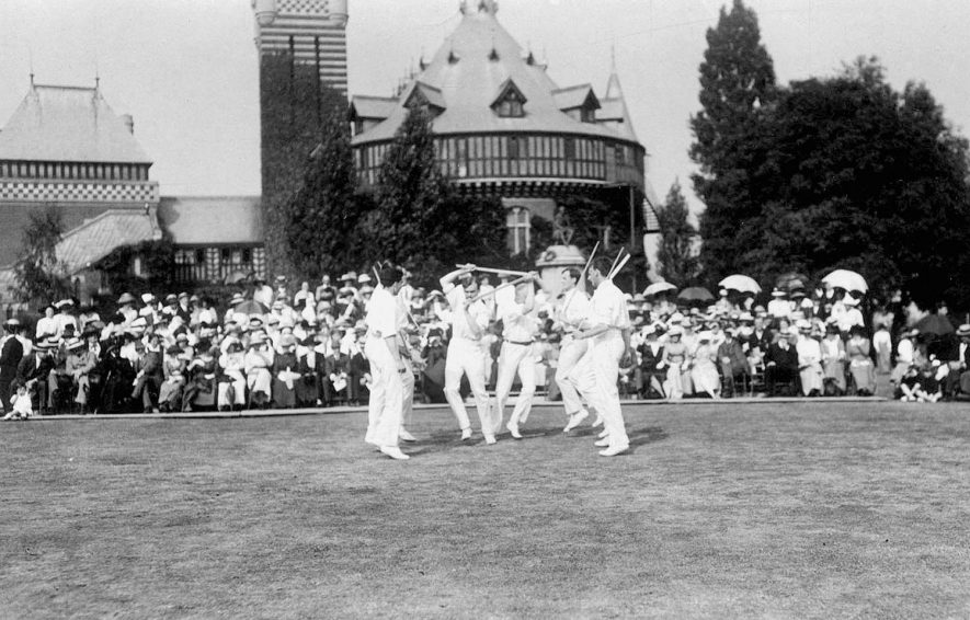 Yorkshire sword dancers and spectators near old Memorial Theatre.  Stratford upon Avon.  1930s.  [These dancers are possibly from the fishing village of Flamborough on the east coast of Yorkshire] |  IMAGE LOCATION: (Warwickshire County Record Office)