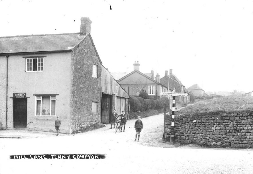Part of village, Mill Lane, showing housing and butcher's shop, Fenny Compton.  1930s |  IMAGE LOCATION: (Warwickshire County Record Office)