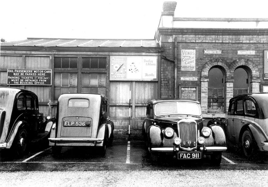 Cars outside the railway station, Stratford upon Avon.  1954 |  IMAGE LOCATION: (Warwickshire County Record Office)