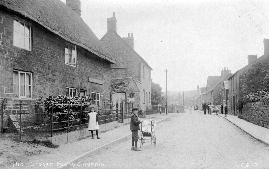 The High Street, Fenny Compton. Girl by railings, boy with pram.  1900s |  IMAGE LOCATION: (Warwickshire County Record Office)