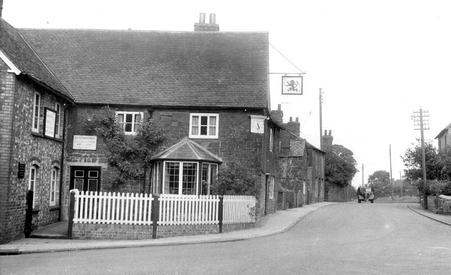 Street with Red Lion public house and cottages, Fenny Compton. Telegraph poles. Lorry.  1950s |  IMAGE LOCATION: (Warwickshire County Record Office)