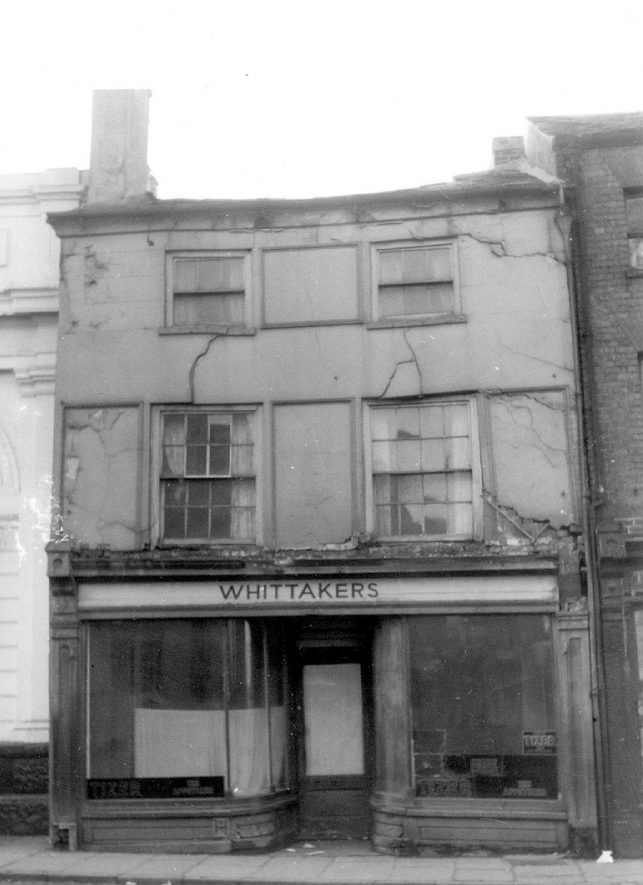 Derelict empty shop previously owned by Whittakers in Market Street, Warwick.  1950 |  IMAGE LOCATION: (Warwickshire County Record Office)