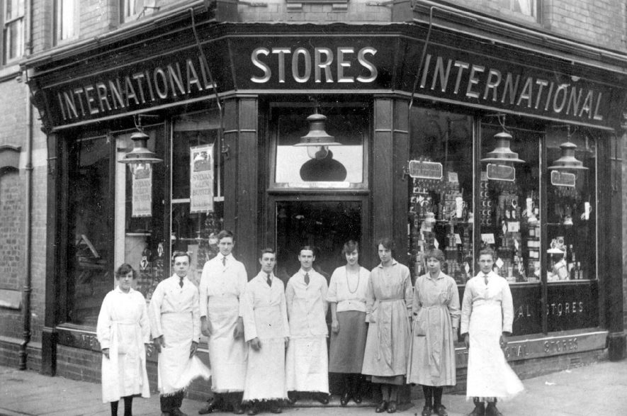 Group of shop workers standing in front of the International stores in Brook Street, Warwick.  1910s. |  IMAGE LOCATION: (Warwickshire County Record Office)