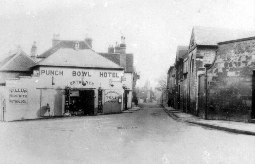The Punch Bowl hotel and petrol filling station at the top of The Butts, Warwick.  1920s. |  IMAGE LOCATION: (Warwickshire County Record Office)