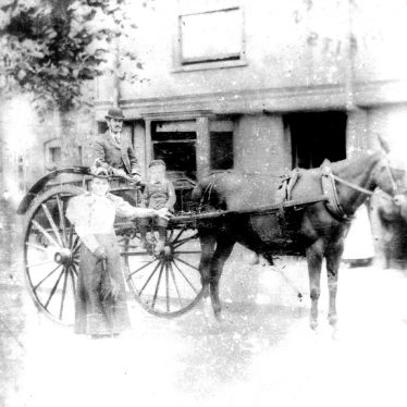 Warwick.  Family in horse drawn carriage