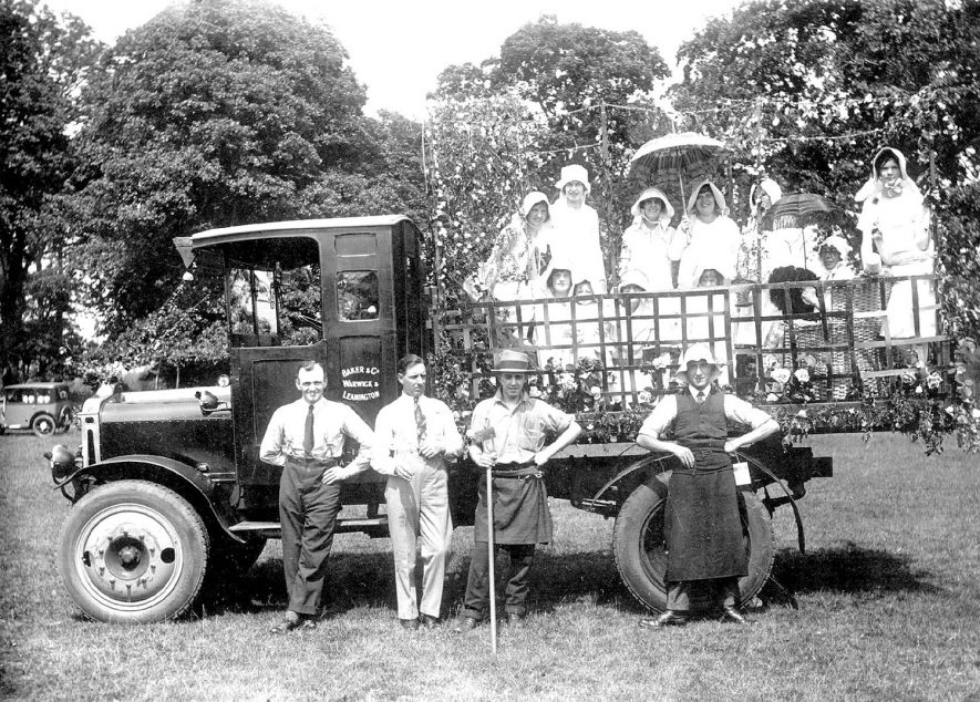 A carnival float in Warwick in 1920s. The lorry was owned by Baker & Co of Warwick & Leamington Spa |  IMAGE LOCATION: (Warwickshire County Record Office)