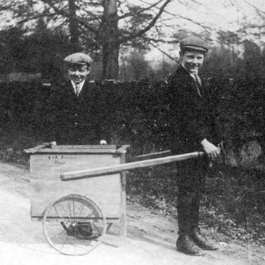 Fillongley.  Two boys with hand-cart