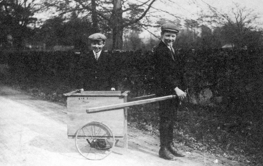 Two boys with hand-cart at side of road, Fillongley.  1910s |  IMAGE LOCATION: (Warwickshire County Record Office)