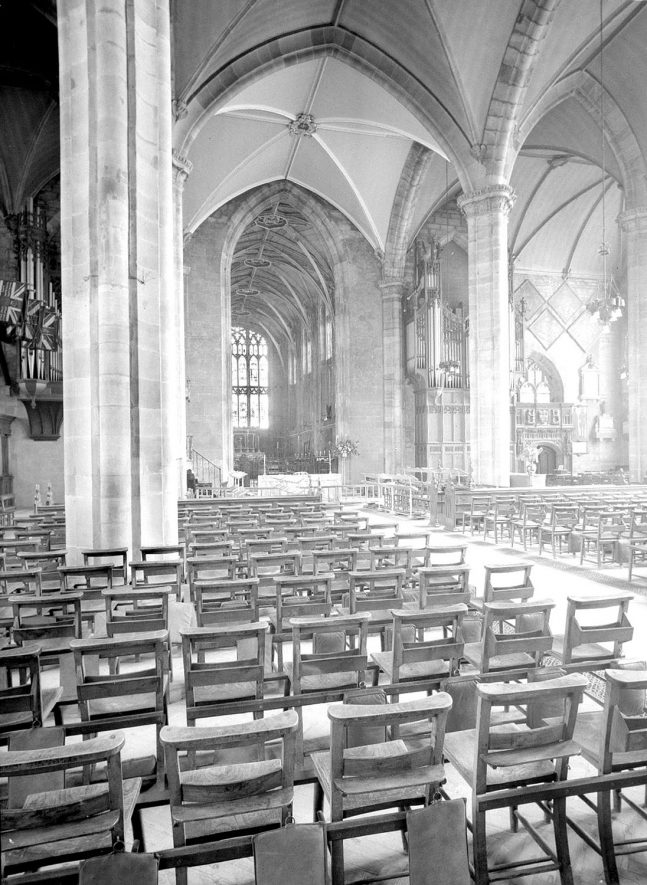 Interior of St. Mary's Church, Warwick, showing a view of the nave looking east.  1960s |  IMAGE LOCATION: (Warwickshire County Record Office)