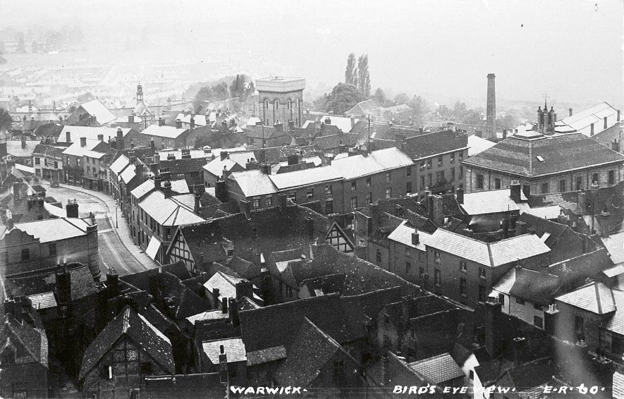 A view across Warwick from St Mary's tower showing the museum and the old water tower.  1920s    IMAGE LOCATION: (Warwickshire County Record Office)