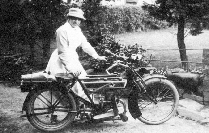 Nurse posing with motor cycle, Fillongley.  1900s |  IMAGE LOCATION: (Warwickshire County Record Office)