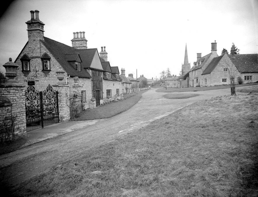 Village green and stone cottages, with the church in the distance, Tredington.  1958 |  IMAGE LOCATION: (Warwickshire County Record Office)