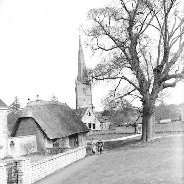 Tredington.  Parish Church and thatched building