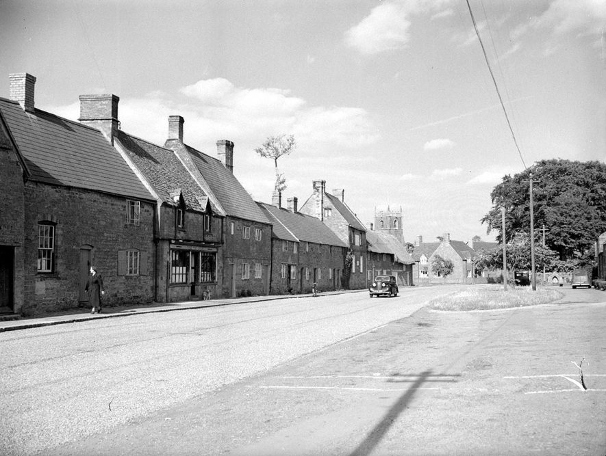 Main Street with cottages, showing the church in the distance, Middle Tysoe.  1953. |  IMAGE LOCATION: (Warwickshire County Record Office)