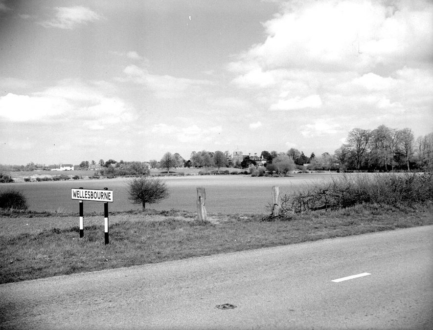 Wellesbourne.  Road into village.  Church tower just visible |  IMAGE LOCATION: (Warwickshire County Record Office)