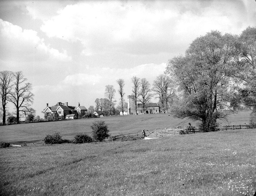 Whatcote.  View across meadows towards the church and houses |  IMAGE LOCATION: (Warwickshire County Record Office)