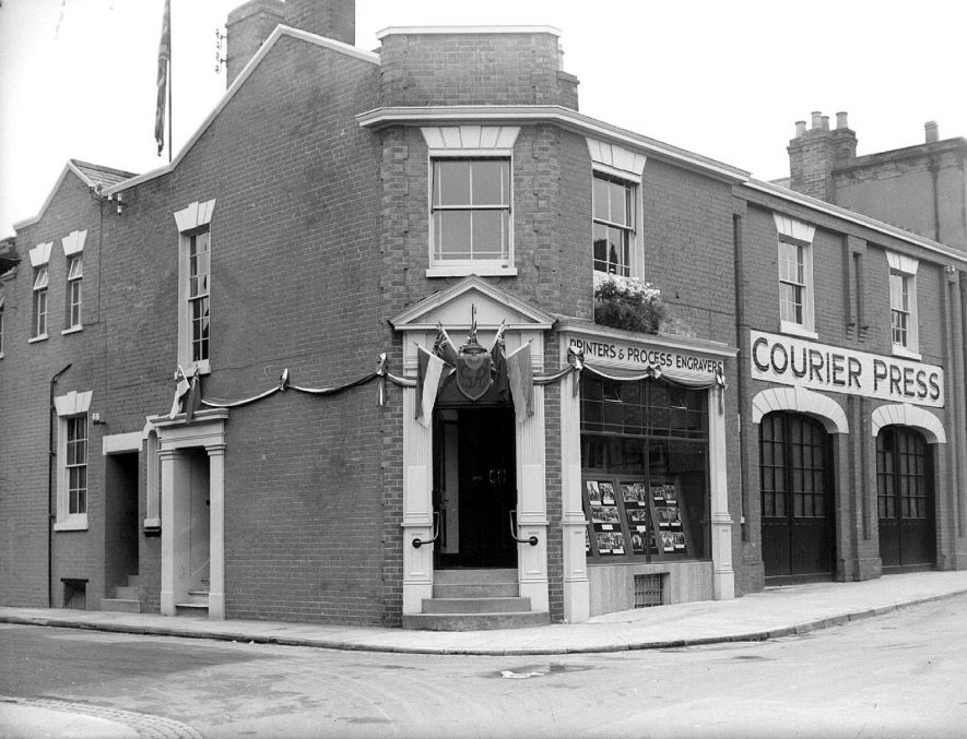 Leamington Spa. Offices of The Leamington Spa Courier Press decorated for the Coronation 12/05/1937 |  IMAGE LOCATION: (Warwickshire County Record Office)