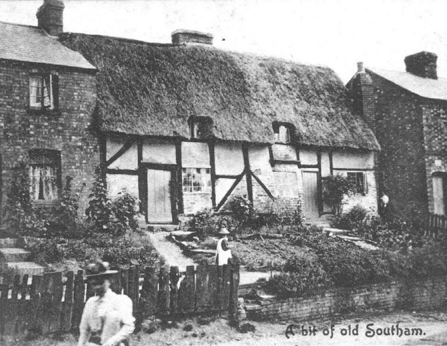 'A bit of old Southam'; thatched cottage in Banbury Road with woman and child in front.  Circa 1900s |  IMAGE LOCATION: (Warwickshire County Record Office)