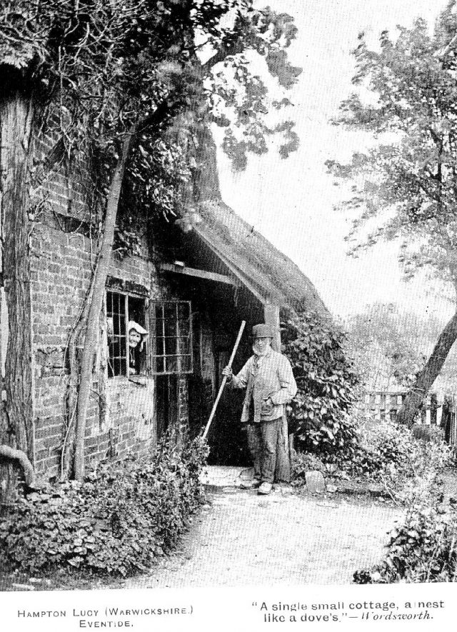 Avon Cottage with George Neale standing outside and his wife May looking out of the window, Hampton Lucy.  1890 |  IMAGE LOCATION: (Warwickshire County Record Office) PEOPLE IN PHOTO: Neale, Mrs May, Neale, George, Neale as a surname