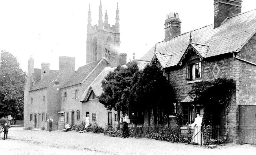 Hampton Lucy showing cottages and church tower.  1900s |  IMAGE LOCATION: (Warwickshire County Record Office)