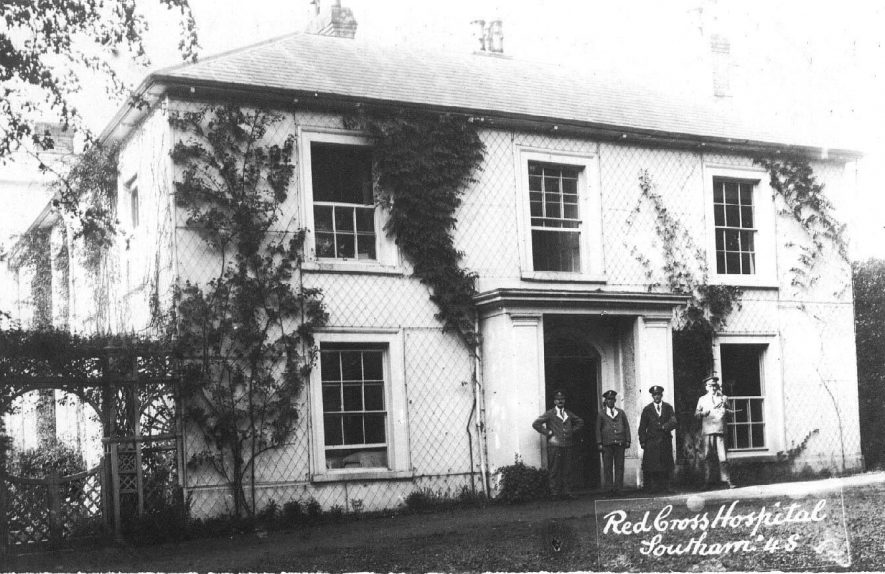 Red Cross Hospital,  The Springs, Coventry Road; view of the front of the building with four uniformed men outside.  Photo:  no.45.  c.1915 |  IMAGE LOCATION: (Warwickshire County Record Office) IMAGE DATE: (c.1915)