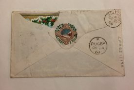 The back of the envelope. The two postmarks from Rugby and Stamford are marked clearly. See also the charming seal design, 'A Merry Xmas' and the tiny embossed heart-shape, which is the mark of the manufacturer. | Warwickshire County Record Office reference CR4651/190