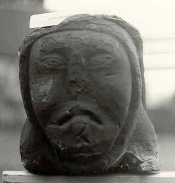 An architectural fragment, the head of a nun, from the Church of St Editha, Polesworth | Warwickshire County Council