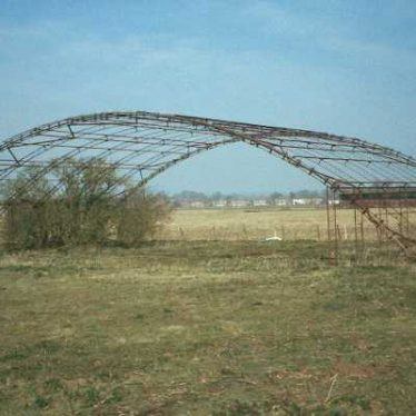 The frame of a Miskins steel blister hangar at RAF Warwick, a Second World War airfield | Warwickshire County Council