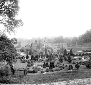 A view of the topiary garden at Compton Wynyates with the house in the background | Warwickshire County Council