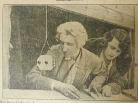 'Directing Warwick Pageant', newspaper clipping showing Gwen Lally using a microphone to direct the pageant. | Warwickshire County Record Office reference CR4157