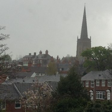 Church of St Peter and St Paul, Coleshill. The church is in the distance, and the spire looms over the housing of the town. | Image courtesy of Zak Cart