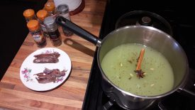 Ready to boil the mixture. A lurid green liquid is on the right, with spice sticks to the left. | Image courtesy of Karen Moulder