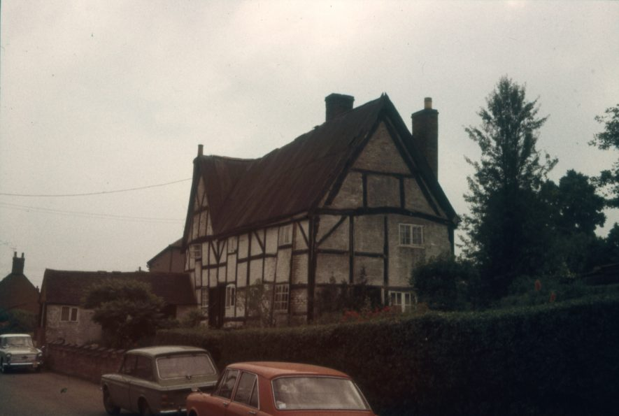 The property was known locally as the Parrott House after its owner. It was subsequently sold, taken apart and rebuilt in Milton Keynes. Image showing the house from the road, 1966. | Warwickshire County Record Office reference PH 1307/1