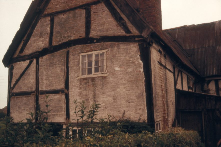 The property was known locally as the Parrott House after its owner. It was subsequently sold, taken apart and rebuilt in Milton Keynes. Image showing a dilapidated gable end, 1966. | Warwickshire County Record Office reference PH 1307/2