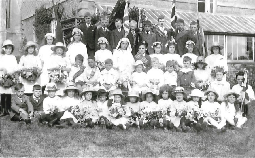 Hampton Lucy Approx. 1920. Photograph of unknown event with Ruby Ellen James on extreme left. Ruby Ellen James was born in Hampton Lucy on May 30 1910, daughter of Robert and Edith Hannah James. | Image courtesy of John Redfern (son of Ruby Ellen Redfern (nee James)