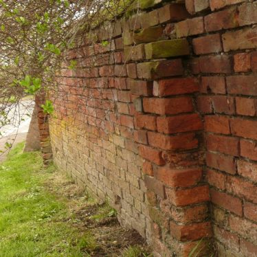 An 18th(?) century garden wall to a garden facing the Lunt Fort. The wall's location suggests it was associated with Baginton Hall. | Image courtesy of William Arnold