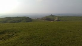 Circular ditch feature on Harts Hill, Burton Dassett. The beacon can be seen in the distance. | Image courtesy of David Davis