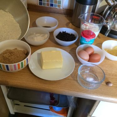 The ingredients for luncheon cake. A selection of foodstuffs are placed on the table. | Image courtesy of Clare Murdoch
