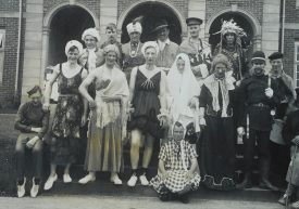 A postcard showing staff and/or patients in fancy dress, outside the King Edward VII Memorial Hospital, Warwick, c.1930s. | Warwickshire County Record Office reference PH1009/2-9