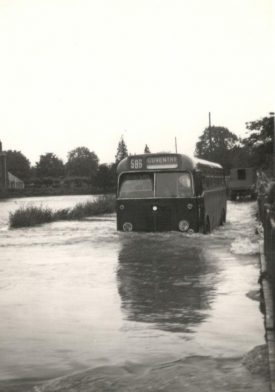 The 586 bus in floods, Wolston. 1970s.