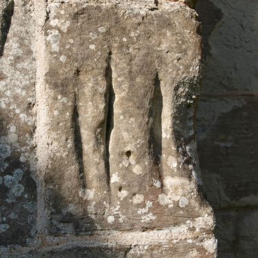 Arrow sharpening slits on the church wall from a time when men were expected to practice archery every Sunday. | Image courtesy of Caroline Irwin